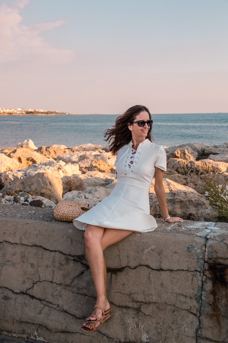 posing for photos on the stone wall at Paphos Harbour, Cyprus