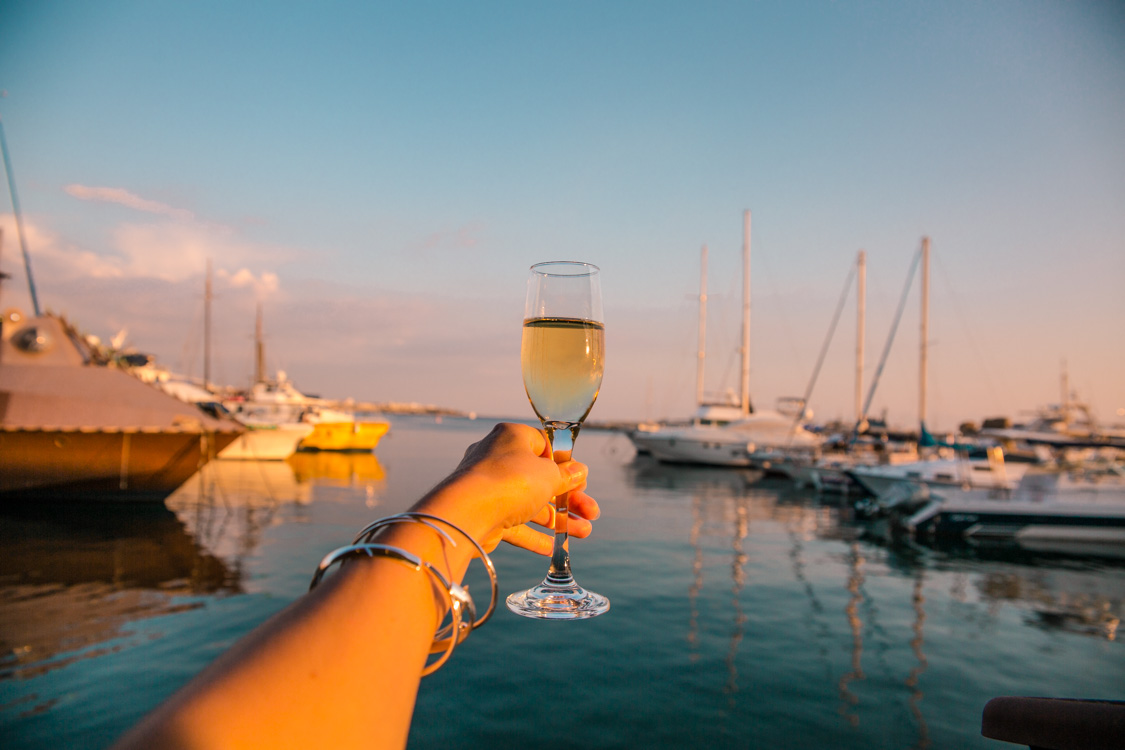 raising a glass of sparkling at Paphos Harbour restaurant, Cyprus