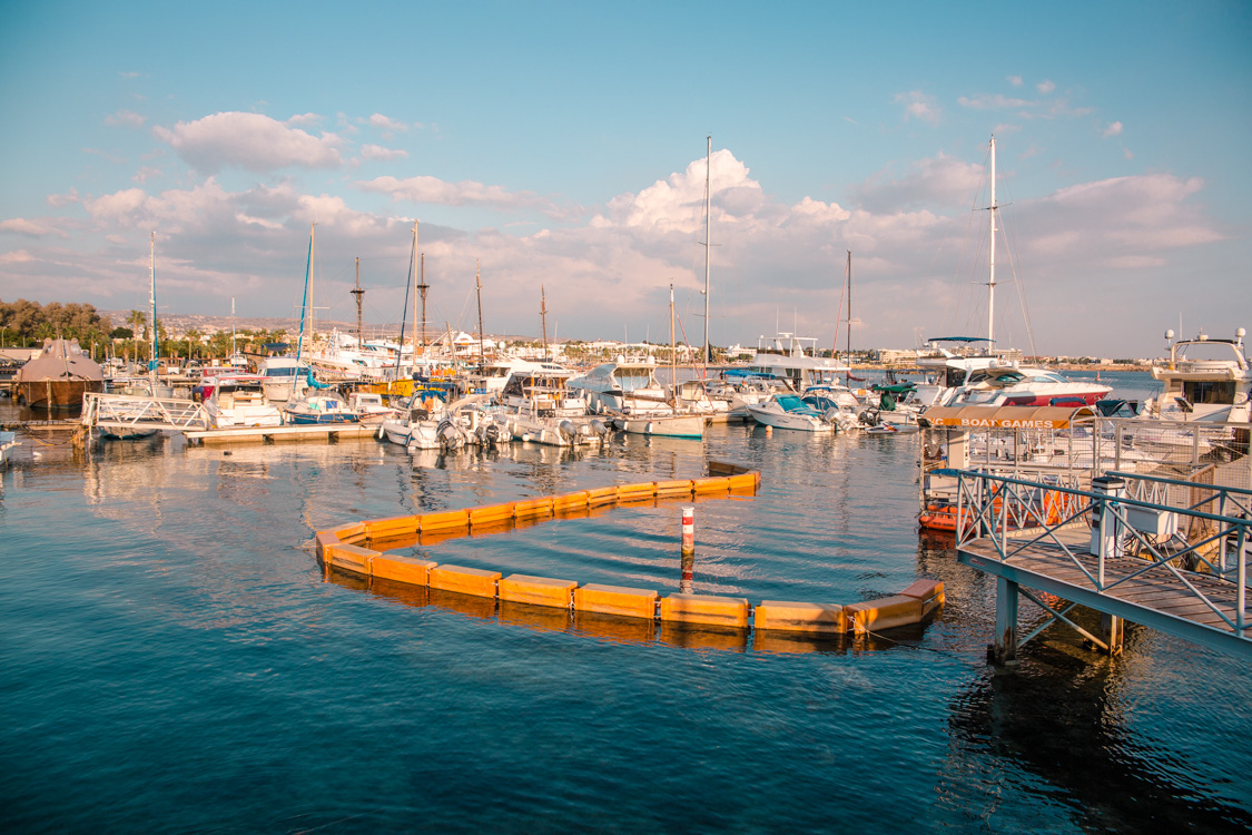 view of boats parked Paphos Harbour, Cyprus looking over towards the city